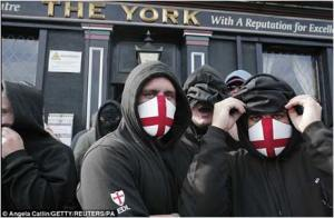 Masked EDL demonstrators